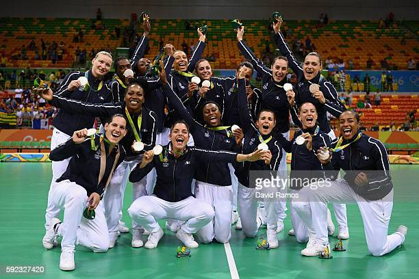 Silver medalists of France celebrate following the medal ceremony for the Women's Handball contest at Future Arena on Day 15 of the Rio 2016 Olympic...