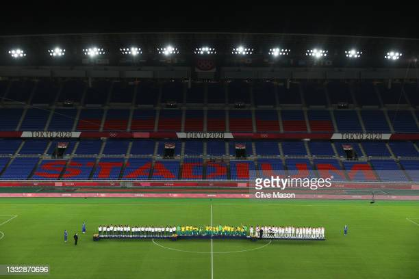 Silver medalists of Team Spain, Gold medalists of Team Brazil and Bronze medalists of Team Mexico stand on the podium as the empty stadium can be...