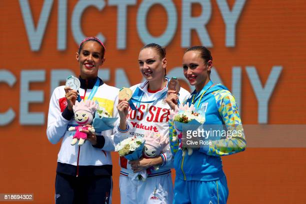 Silver medalists Ona Carbonell of Spain gold medalists Svetlana Kolesnichenko of Russia and bronze medalists Anna Voloshyna of Ukraine pose with the...