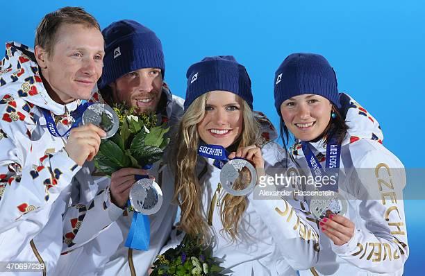 Silver medalists Ondrej Moravec, Jaroslav Soukup, Gabriela Soukalova and Veronika Vitkova of the Czech Republic celebrate during the medal ceremony...