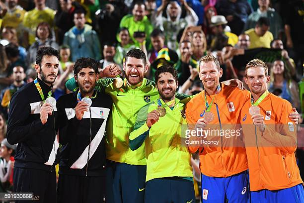Silver medalists Paolo Nicolai and Daniele Lupo of Italy, gold medalists Alison Cerutti and Bruno Schmidt Oscar of Brazil and bronze medalists...
