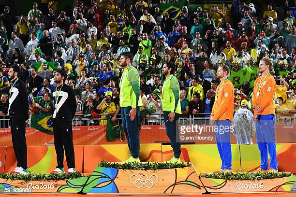 Silver medalists Paolo Nicolai and Daniele Lupo of Italy gold medalists Alison Cerutti and Bruno Schmidt Oscar of Brazil and bronze medalists...