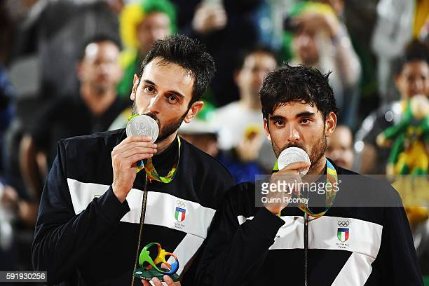 Silver medalists Paolo Nicolai and Daniele Lupo of Italy pose on the podium during the medal ceremony for the Men's Beachvolleyball contest at the...