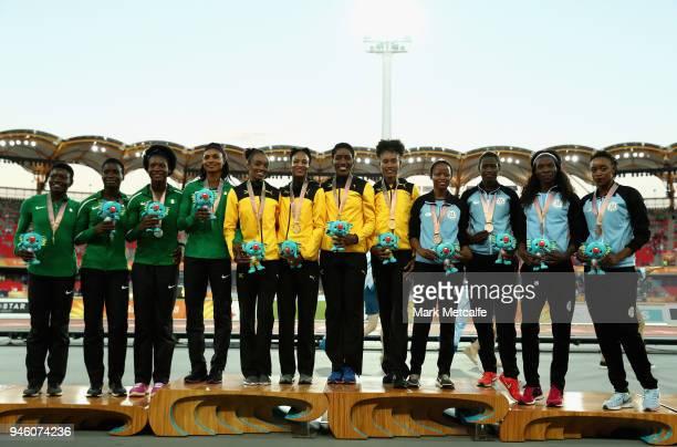 Silver medalists Patience Okon George Glory Onome Nathaniel Praise Idamadudu and Yinka Ajayi of Nigeria gold medalists Janieve Russell Christine Day...