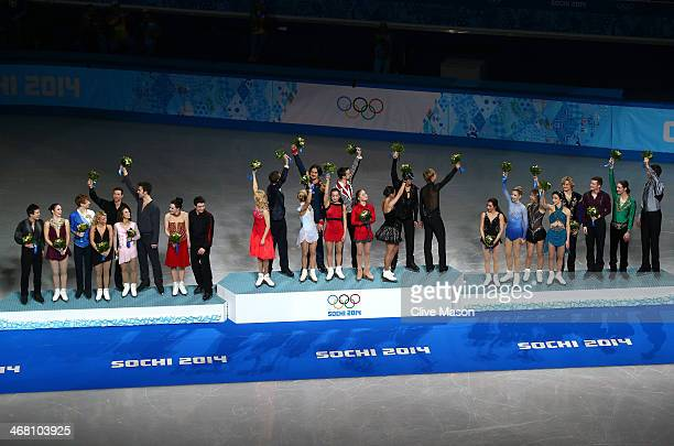 Silver medalists Patrick Chan, Kaetlyn Osmond, Kevin Reynolds, Kirsten Moore-Towers, Dylan Moscovitch, Meagan Duhamel, Eric Radford, Tessa Virtue and...