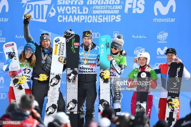 Silver medalists Patrizia Kummer of Switzerland and Benjamin Karl of Austria gold medalists Andreas Prommegger of Austria and Ester Ledecka of the...