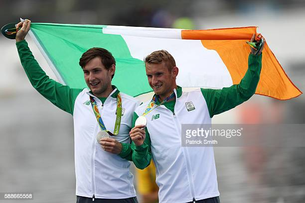 Silver medalists Paul O'Donovan and Gary O'Donovan of Ireland celebrate after the medal ceremony for the Lightweight Men's Double Sculls on Day 7 of...