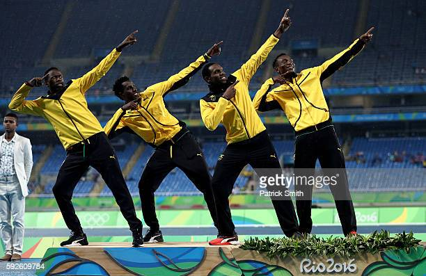 Silver medalists Peter Matthews Javon Francis Naton Allen and Fitzroy Dunkley of Jamaica stand on the podium during the medal ceremony for the Men's...