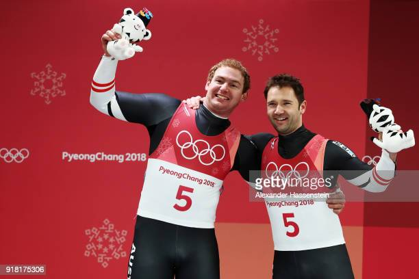 Silver medalists Peter Penz and Georg Fischler of Austria celebrate during the victory ceremony after the Luge Doubles on day five of the PyeongChang...