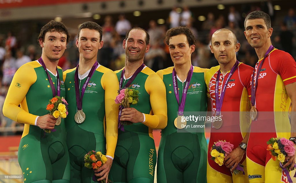 Silver medalists Pilot Bryce Lindores and Sean Finning of Australia, Gold medalists Pilot Scott McPhee and Kieran Modra of Australia and bronze medalists Pilot Diego Javier Munoz and Miguel Angel Clemente Solano of Spain pose on the podium during the victory ceremony for the Men's Individual B Pursuit on day 1 of the London 2012 Paralympic Games at Velodrome on August 30, 2012 in London, England.