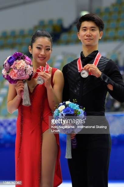 Silver medalists Rikako Fukase and Eichu Cho of Japan pose for photograpgs on the podium during the medals ceremony of the Ladies Free Skating on day...