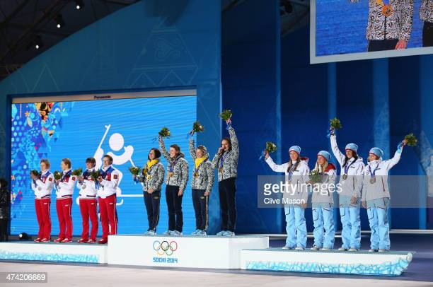 Silver medalists Russia gold medalists Ukraine and bronze medalists Norway celebrate during the medal ceremony for the Biathlon Women's 4 x 6 km...