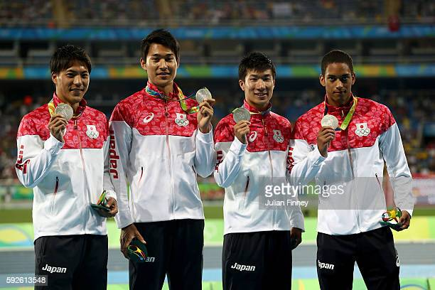 Silver medalists Ryota Yamagata Iizuka Shota Yoshihide Kiryu and Aska Cambridge of Japan stand on the podium during the medal ceremony for the Men's...