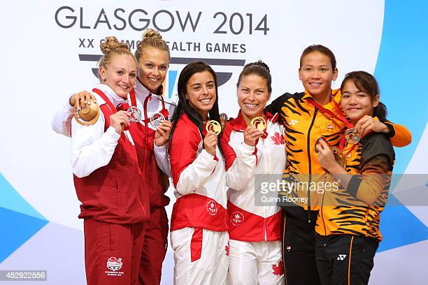 Silver medalists Sarah Barrow and Tonia Couch of England gold medalists Meaghan Benfeito and Roseline Filion of Canada and bronze medalists Pandelela...