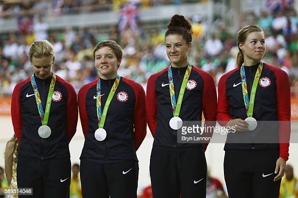 Silver medalists Sarah Hammer Kelly Catlin Chloe Dygert and Jennifer Valente of the United States celebrate on the podium at the medal ceremony for...