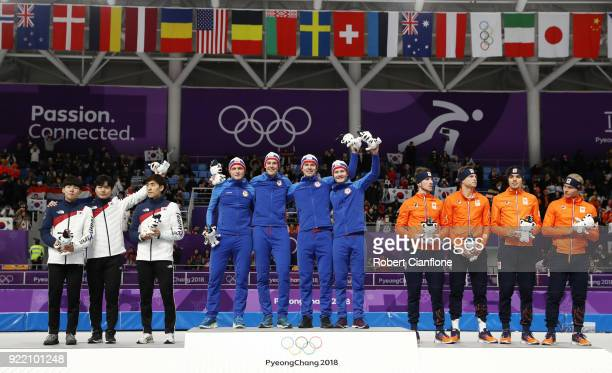 Silver medalists Seung-Hoon Lee, Jaewon Chung and Min Seok Kim of Korea, gold medalists Havard Bokko, Sindre Henriksen, Simen Spieler Nilsen and...