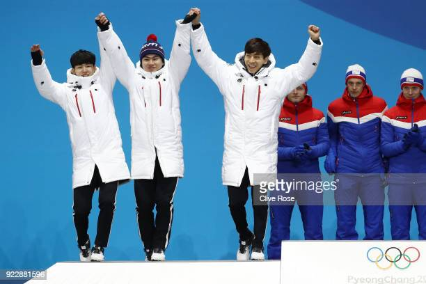 Silver medalists Seung-Hoon Lee, Jaewon Chung, Min Seok Kim of Korea celebrate during the medal ceremony for Speed Skating - Men's Team Pursuit on...
