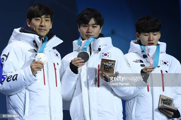 Silver medalists SeungHoon Lee Jaewon Chung Min Seok Kim of Korea celebrate during the medal ceremony for Speed Skating Men's Team Pursuit on day 13...
