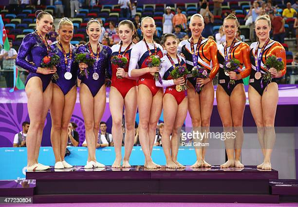 Silver medalists Sophie Scheder Elisabeth Seitz and Leah Griesser of Germany gold medalists Aliya Mustafina Victoria Komova and Seda Tutkhalyan of...