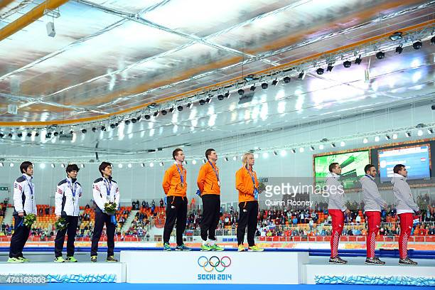Silver medalists South Korea gold medalists Netherlands and bronze medalists Poland celebrate on the podium during the medal ceremony for the Speed...