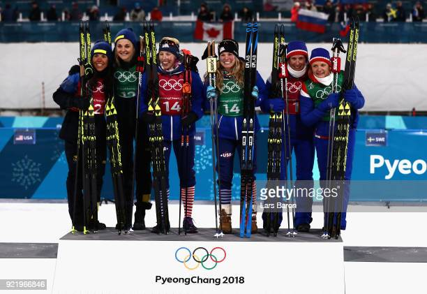 Silver medalists Stina Nilsson and Charlotte Kalla of Sweden gold medalists Kikkan Randall and Jessica Diggins of the United States and bronze...