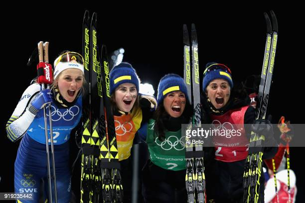 Silver medalists Stina Nilsson Ebba Andersson Charlotte Kalla and Anna Haag of Sweden celebrate after the Ladies' 4x5km Relay on day eight of the...