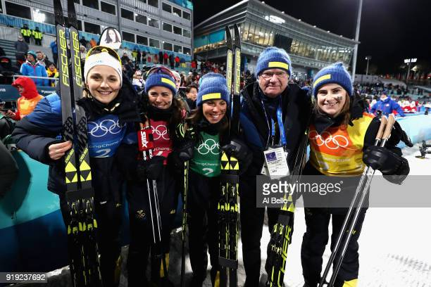 Silver medalists Stina Nilsson Ebba Andersson Charlotte Kalla and Anna Haag of Sweden celebrate with King Carl Gustaf of Sweden after the Ladies'...