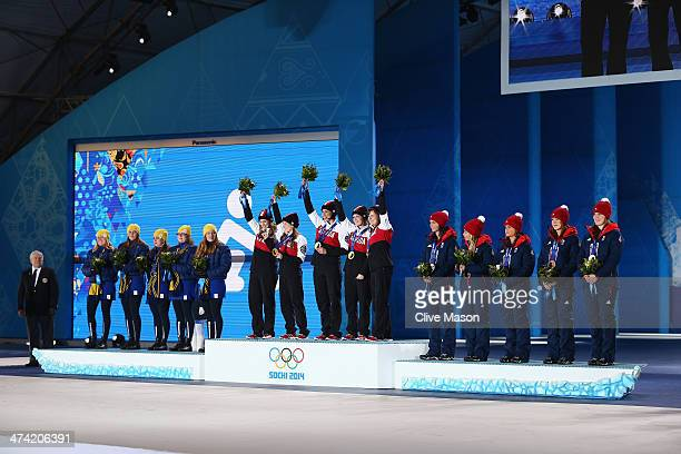 Silver medalists Sweden gold medalists Canada and bronze medalists Great Britain celebrate during the medal ceremony for Women's Curling on Day 15 of...