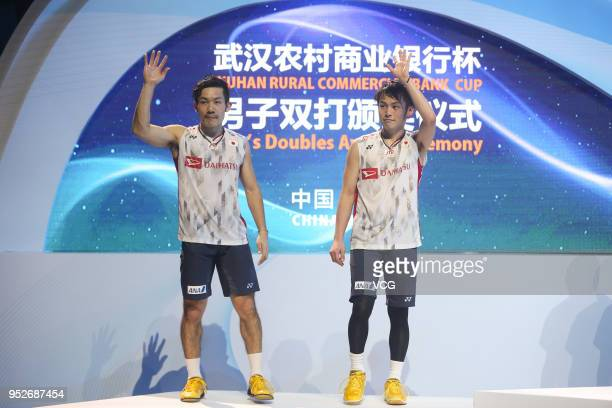 Silver medalists Takeshi Kamura of Japan and Keigo Sonoda of Japan pose during men's doubles final match on day six of 2018 Badminton Asia...
