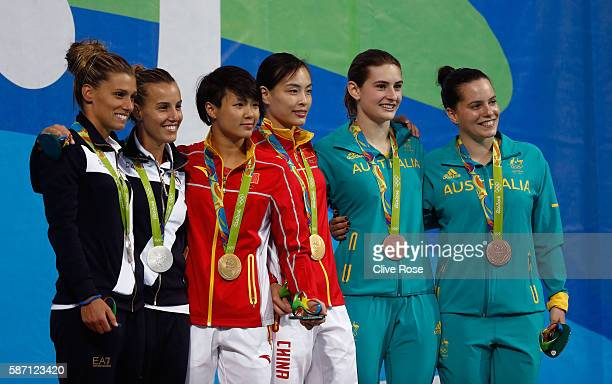 Silver medalists Tania Cagnotto and Francesca Dallape of Italy gold medalists Tingmao Shi and Minxia Wu of China and bronze medalists Maddison Keeney...