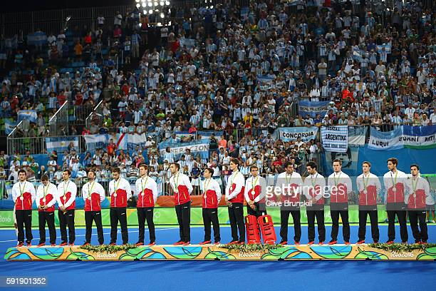 Silver medalists Team Belgium pose on the podium during the medal ceremony for the Men's Hockey Gold Medal match between Belgium and Argentina on Day...