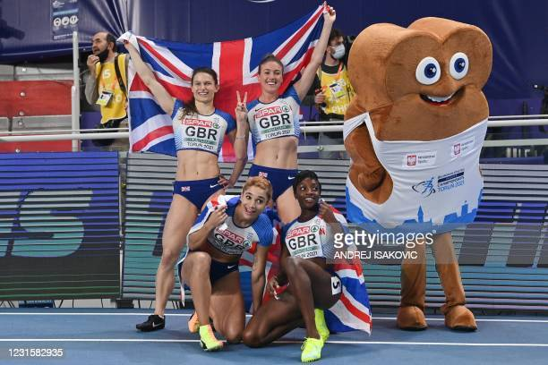 Silver medalists team Britain celebrates after the women's 4x400m relay at the 2021 European Athletics Indoor Championships in Torun on March 7, 2021.