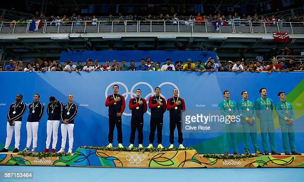 Silver medalists Team France gold medalists Team USA and bronze medalists Team Australia pose on the podium during the medal ceremony for the Final...