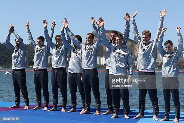 Silver medalists Team Germany celebrate on the podium at the medal ceremony for the Men's Eight on Day 8 of the Rio 2016 Olympic Games at the Lagoa...