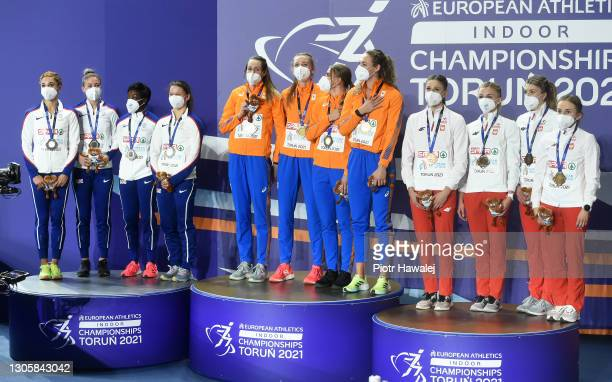 Silver medalists Team Great Britain, gold medalists Team Netherlands and bronze medalists team Poland pose for a photo during the medal ceremony for...