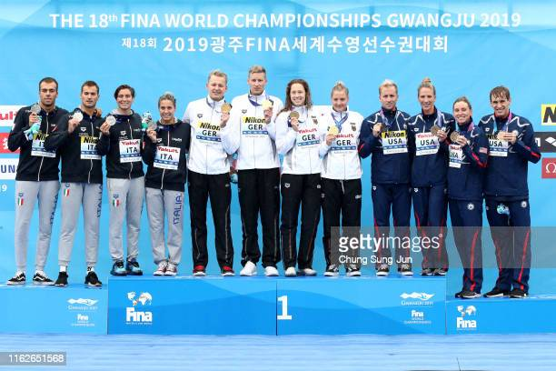 Silver medalists Team Italy gold medalists Team Germany and bronze medalist Team USA pose during the medal ceremony for the Mixed 5km Relay Final on...