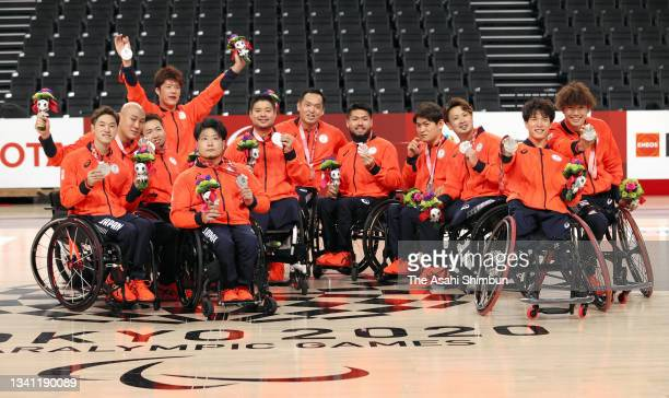 Silver medalists Team Japan pose after the Wheelchair Basketball Men's Gold Medal match between United States and Japan on day 12 of the Tokyo 2020...