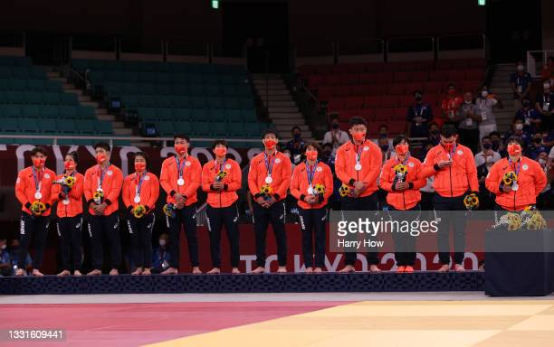 Silver Medalists Team Japan pose on the podium for Judo the Mixed Team Final on day eight of the Tokyo 2020 Olympic Games at Nippon Budokan on July...