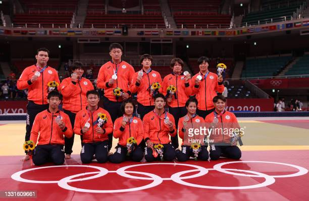 Silver Medalists Team Japan with their silver medals for Judo the Mixed Team Final on day eight of the Tokyo 2020 Olympic Games at Nippon Budokan on...