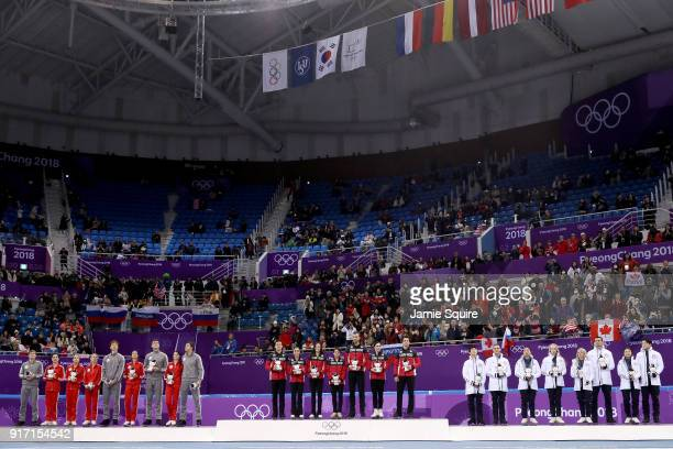 Silver medalists Team Olympic Athlete from Russia gold medalists Team Canada and bronze medalists Team United States celebrate during the victory...