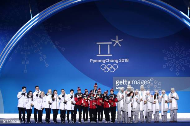 Silver medalists Team Olympic Athlete from Russia gold medalists Team Canada and bronze medalists Team United States celebrate during the medal...