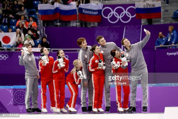 Silver medalists Team Olympic Athlete from Russia take a photo on the podium during the victory ceremony after the Figure Skating Team Event on day...