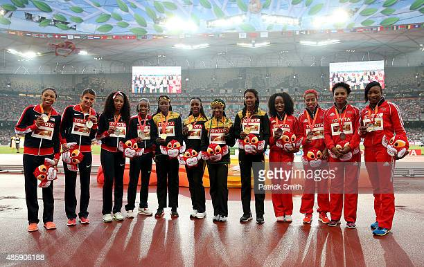 Silver medalists Team USA gold medalists Team Jamaica and bronze medalists Team Trinidad and Tobago pose on the podium during the medal ceremony for...