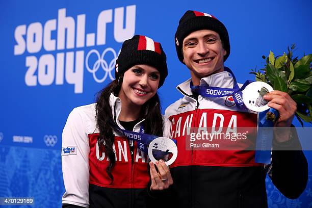 Silver medalists Tessa Virtue and Scott Moir of Canada celebrate during the medal ceremony for the Figure Skating Ice Dance celebrate on the podium...