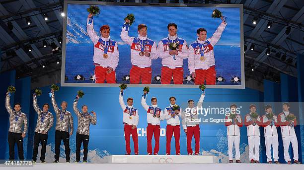 Silver medalists the United States, gold medalists Russia and bronze medalists China celebrate on the podium during the medal ceremony for the Men's...