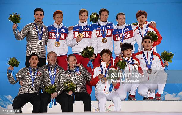 Silver medalists the United States gold medalists Russia and bronze medalists China celebrate on the podium during the medal ceremony for the Men's...
