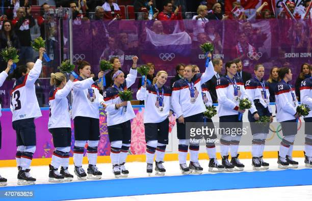 Silver medalists the United States react during the flower ceremony for the Ice Hockey Women's Gold Medal Game on day 13 of the Sochi 2014 Winter...