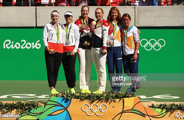 Silver medalists Timea Bacsinszky and Martina Hingis of Switzerland gold medalists Ekaterina Makarova and Elena Vesnina of Russia and bronze...