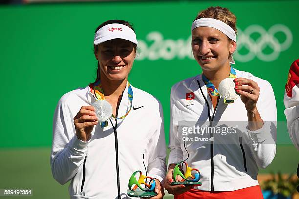 Silver medalists Timea Bacsinszky and Martina Hingis of Switzerland pose on the podium during the ceremony for the women's doubles on Day 9 of the...