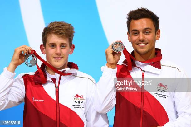 Silver medalists Tom Daley and James Denny of England pose during the medal ceremony for the Men's Synchronised 10m Platform Final at Royal...